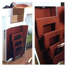 Small Picture Stairs to a loft are hidden in a cabinet then fold out when needed