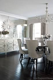 an elegant white decor for a dining room with an ice castle resemblance created by the mirrored wall