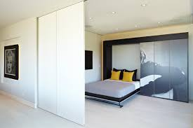 Example of a mid-sized trendy guest light wood floor and beige floor  bedroom design