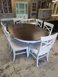 this is a four foot round table with a built in leaf i painted it a light gray with heavy distressing the dimensi