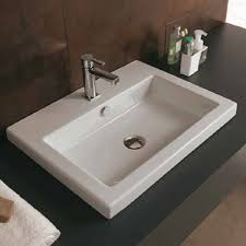modern rectangle sink shown as a semi recessed with single hole faucet drilling