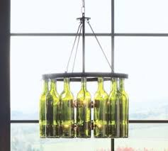 authentic green glass wine bottles lend artistic impact to this wine bottle chandelier from pottery barn it has a rasped finish that gives each individual artistic lighting fixtures