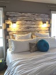 #GuestRooms Better pic of headboard out of old fencing. Hubby added lights.  Total
