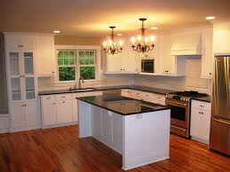 image of refinishing kitchen cabinet doors with light chandelier