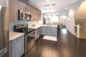 dark hardwood floors kitchen white cabinets. White Wood Surround Fireplace Mantel Dark Floors With Cabinets Backsplash Tile Ideas Grey Wooden Countertops Island In Hardwood Kitchen