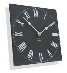 above measuring 10 inches square the recycled traditional outdoor clock features roman numerals it looks and feels like slate but is made in the uk from
