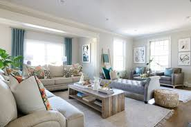 a stylish family room that s both chic and family friendly featuring neutral furniture and thoughtful sofa