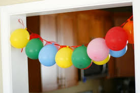 them on the ground for the kids to play with as they arrive or tape them to a ribbon and hang them as a wall or door decoration for a balloon garland