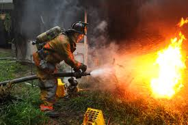 u s department of defense photo essay army pvt 1st class lucas ternell puts out a small debis fire in the yard