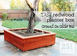 Redwood planter box around a tree with seating - DIY