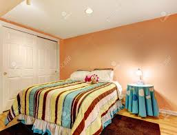 Peach Color Bedroom Peach Color Kids Room With Bed In Happy Striped Bedding Stock