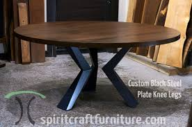custom made solid black walnut round dining top with custom made welded steel knee legs handcrafted