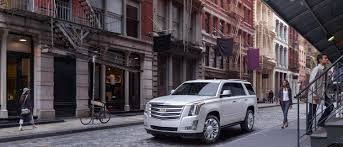 2018 cadillac escalade lifestyle downtown background