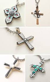 These new cross designs feature enamel, mixed metals and mother of pearl.  See all new styles. | New jewellery design, Jewelry design, Cross designs