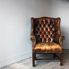 antique brown tufted leather wingback chair with wooden base for home furniture ideas