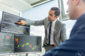 Stock Brokers Businessmen Trading Stocks Online Stock Brokers Looking At Graphs