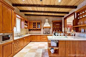 multi colored tile flooring medium toned traditional style cabinetry and island with quartz countertops