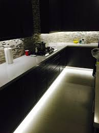 strip lights under kitchen cabinets lovely under cabinet and footwell led strip lighting also counter