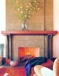 fireplace mantle made of concrete enhances the tile look concrete behind