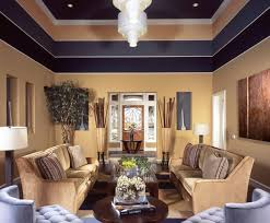 living rooms with black furniture. A Warm Beige On The Bottom Section Of Walls Is Accented By Darker Stripes Living Rooms With Black Furniture