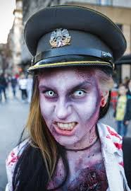 woman with elaborate zombie makeup wearing some sort of military or police costume