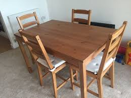 ikea jokkmokk solid pine dining table and 4 chairs with 8 chair covers