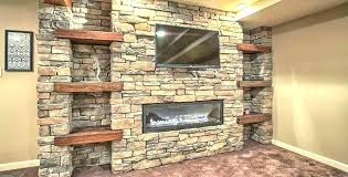 fireplace rock wall gas architectural design how to install river on stones rocks stone remodeled g fireplace rock