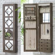 gorgeous wall mounted jewelry armoire with decorated mirror