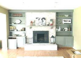 cabinets and shelves beside fireplace built in bookcases around fishers more firepla