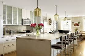 Modern kitchen pendant lights remodel Recessed Niche Modern Pendant Lights Hang Over The Island The Backsplash Of Metalmosaic Tile Is By Architectural Digest 31 Kitchens With Pretty Pendant Lighting Architectural Digest