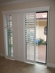 glass sliding doors combine with costco plantation shutters plus outdoor blue chair