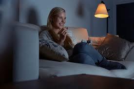 woman watching tv at night. woman watching tv at night g