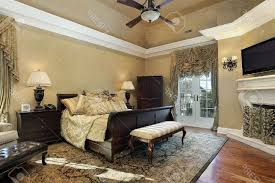 Master Bedroom Fireplace Master Bedroom In Elegant Home With Fireplace Stock Photo Picture
