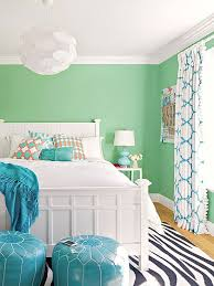 COOL COLORS Mint green walls and teal accents make for a fresh and playful  color palette.The black-blue stripes in a zebra print rug work to ground  the room ...