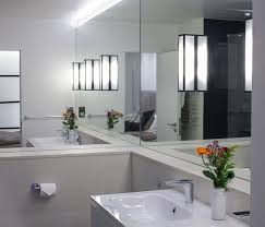 view in gallery minimalist bathroom with mirrored walls