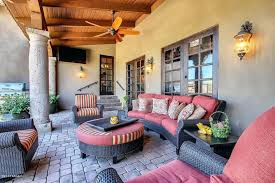 sconce southwestern porch with brick floors wall sconce exposed beam french doors high southwestern wall