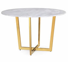 white marble dining table with four gold legs