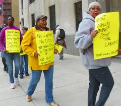 layoffs flood detroit water dept risk public health rising debt members of afscme local 207 protest lay offs takeover of dwsd in front of