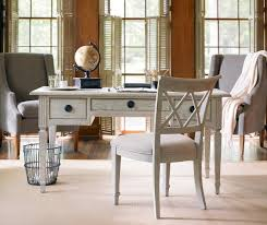 basket trash under old and vintage white wooden desk home office furniture design with drawer chair