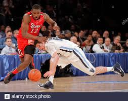 Villanova Wildcats guard Ryan Arcidiacono and St. John's Red Storm forward Chris  Obekpa (12) chase a loose ball during the first half of their NCAA men's  championship basketball game at the 2013