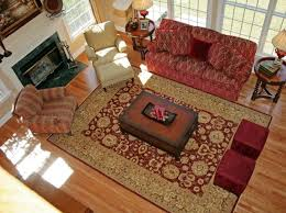 traditional living room with red sofa and oriental area rug