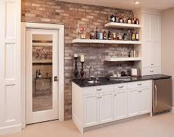 view in gallery elegant home bar with a brick wall backdrop and simple floating shelves design mingle
