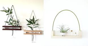 flower shelf these modern hanging wall shelves made from reclaimed wood have a ledge to display