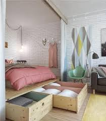 Small Studio Apartment Decorating Tips: Create different levels to define  spaces, use area under