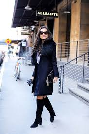 kat tanita oozes smart girl chic in this excellent combination of over the knee boots a navy pin striped skirt and a faux fur collared coat
