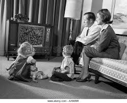 black kids watching tv. 1960s family mom dad 2 kids watching television - stock image black kids watching tv h