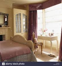 Purple And Cream Bedroom Cream Fitted Wardrobe With Interior Drapes In Traditional Bedroom