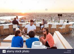 - Photo Fashionable Nuteras At Stock And Young Bar Restaurant Alamy Women 74550375 Rooftop