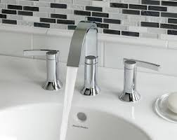 bathroom fixtures. berwick widespread bath faucets lever handle modern bathroom showerheads water flow powerful sink reflection soap fixtures