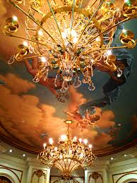 with elaborate crystal heavy chandeliers and over the top ceiling murals